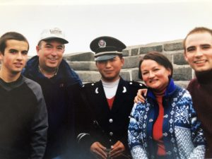 Nik, Allan, Bruni and Kris Michaud posing with a security guard on the Great Wall in 1999.